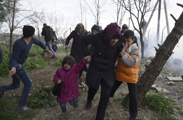 refugees fyrom teargas