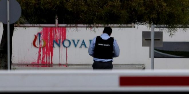 Rouvikonas anarchists attack Novartis offices with sledgehammers and red paint